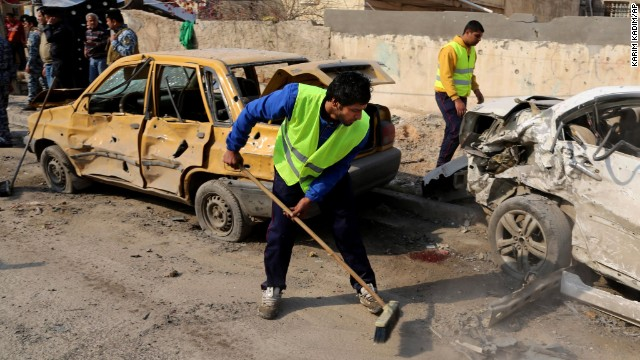 Baghdad municipality workers clean up after a car bomb attack in downtown Baghdad, Iraq on 15 January.