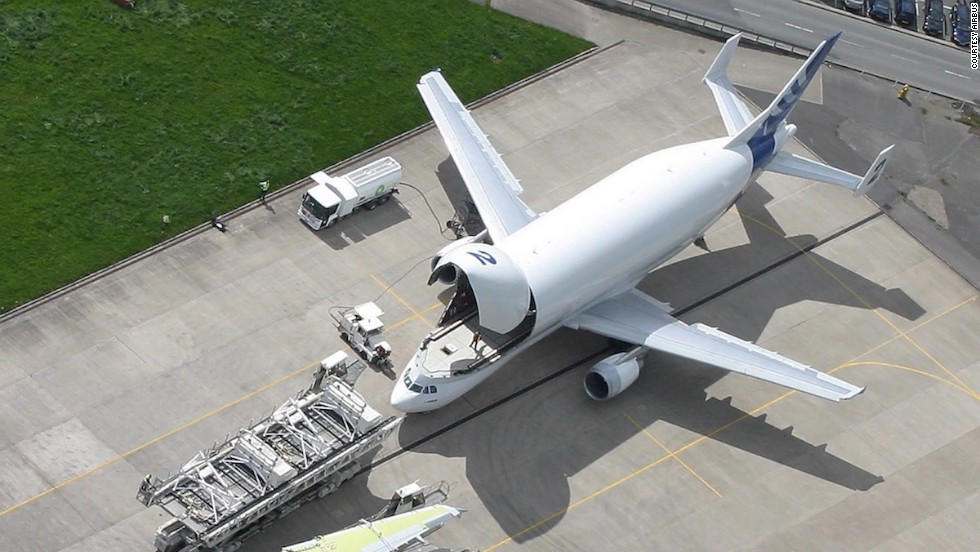 "A Beluga can carry the wings of an A340 airliner or fuselage for Airbus' wide-body <a href=""http://travel.cnn.com/tags/a350"">A350</a>. It's not large enough to transport all parts for the A380 super jumbo. Those travel by boat, barge and road."