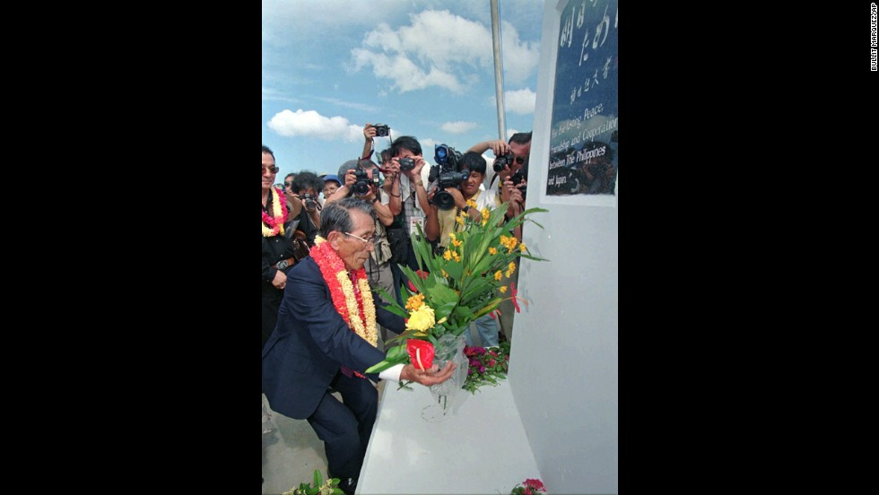 "Onoda lays a wreath at the Philippine-Japan Friendship Shrine at Tilik on Lubang Island in the Philippines in May 1996. Onoda made <a href=""http://www.cnn.com/WORLD/9605/26/philippines.straggler/"">his first visit to the island</a> since coming out of hiding from the jungle there in 1974."