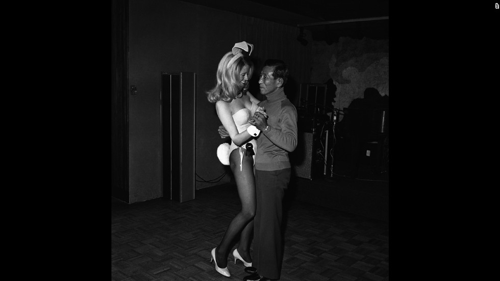 Onoda dances with a Playboy waitress at the Playboy Club in Chicago in 1975 while on a tour of the United States.