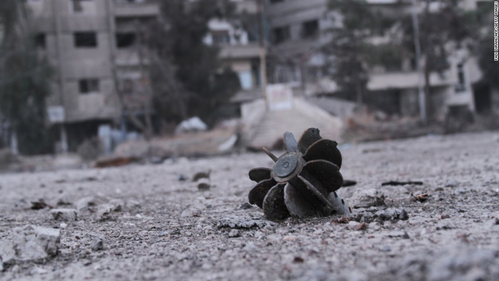 A piece of exploded mortar lies in a street in Daraya, a Syrian city southwest of Damascus, on Friday, January 17.