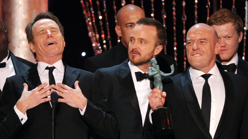 "From left, Bryan Cranston, Aaron Paul and Dean Norris accept the award for outstanding performance by an ensemble in a drama series for ""Breaking Bad."""