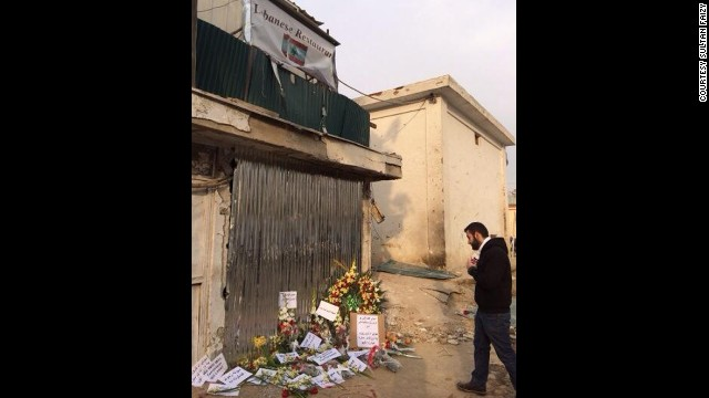 Mourners left flowers outside the beloved Kabul restaurant after the attack.