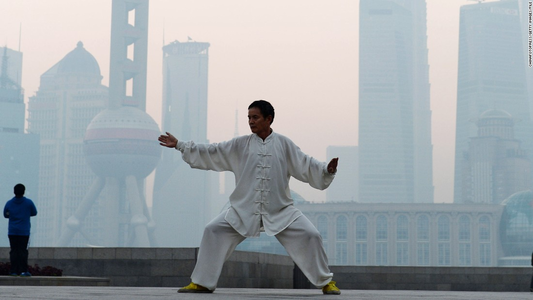 "A man practices Tai Chi in Shanghai as heavy smog engulfs the city on November 7, 2013. In 2010, 40% of the world's premature deaths caused by air pollution were in China, according to a survey <a href=""http://www.thelancet.com/journals/lancet/article/PIIS0140-6736%2813%2962693-8/fulltext?rss=yes"" target=""_blank"">published in the Lancet. </a>"