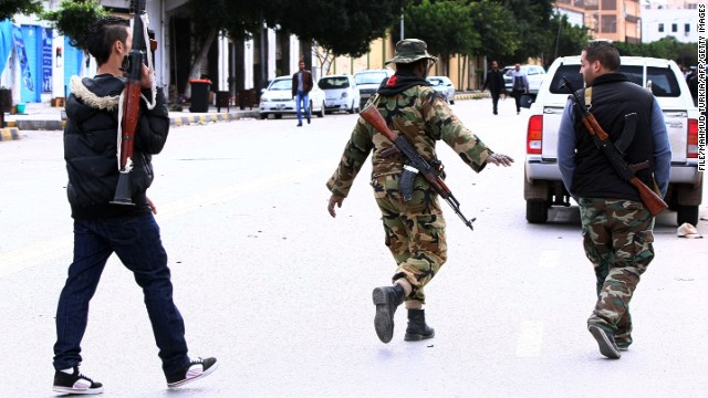 [File photo] Libyan gunmen roam along Zawiyah Street in the Libyan capital Tripoli on January 3, 2012.