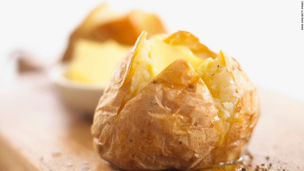 """<strong>Baked potato</strong><br /><br />The potato has been unfairly demonized -- it's actually a potent hunger tamer. In a study that measured the satiating index of 38 foods, including brown rice and whole-wheat bread, people ranked boiled potatoes highest, reporting that they felt fuller and ate less two hours after consuming them. <br /><br />Though potatoes are often shunned because they're considered high in carbohydrates, they shouldn't be. Whether baked or boiled, they're loaded with vitamins, fiber and other nutrients. Result? You get steady energy and lasting fullness after noshing on them.<br /><br /><strong>Feel even fuller:</strong> Eat baked and boiled tubers skin-on to get more fiber for just 160 calories a pop.<br /><br /><a href=""""http://www.health.com/health/gallery/0,,20645136,00.html"""" target=""""_blank"""">Health.com: 26 reasons to love potatoes </a>"""