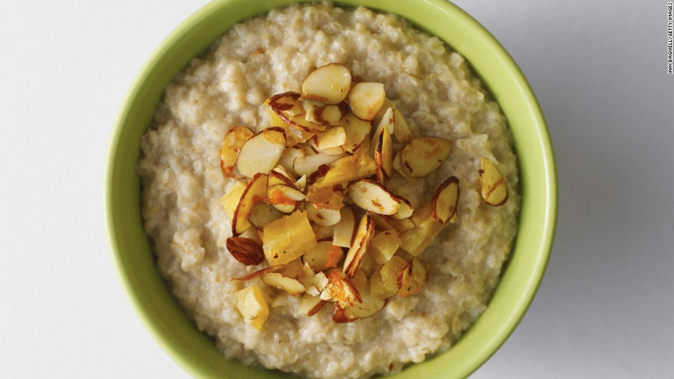 "<strong>Oatmeal</strong><br /><br /><a href=""http://www.health.com/health/gallery/0,,20306673,00.html"" target=""_blank"">Oatmeal</a>'s filling force comes from its high fiber content and its uncanny ability to soak up liquid like a sponge. When cooked with water or skim milk, the oats thicken and take more time to pass through your digestive system, meaning you'll go longer between hunger pangs.<br /><br /><strong>Feel even fuller:</strong> Sprinkle almonds on top of your bowl. ""The nuts pack protein and fiber and contain unsaturated fats that can help stabilize insulin levels,"" regulating blood sugar, Katz says.<br /><br /><a href=""http://www.health.com/health/gallery/0,,20735735,00.html"" target=""_blank"">Health.com: 13 comfort foods that burn fat</a>"