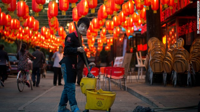 What's with the bucket, pal? No cleaning allowed on the first day of Lunar New Year.
