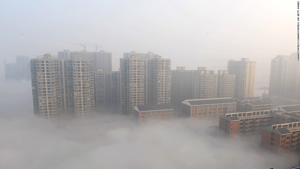 Smog shrouds buildings in Changsha in Hunan province on January 14.