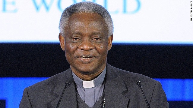 Ghanaian Cardinal Peter Turkson reads to the audience a message sent by Pope Francis on the eve of the opening of the forum in Davos on January 21, 2014. Some 40 world leaders gather in the Swiss ski resort Davos to discuss and debate a wide range of issues including the causes of conflicts plaguing the Middle East and how to reinvigorate the global economy. AFP PHOTO ERIC PIERMONTERIC PIERMONT/AFP/Getty Images