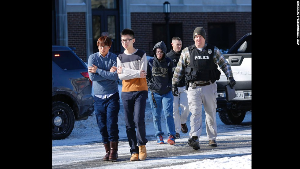 Police evacuate students from the electrical engineering building. A suspect is in custody, a Purdue spokeswoman says.