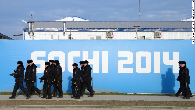 "SOCHI, RUSSIA - JANUARY 07:  (CHINA OUT, SOUTH KOREA OUT) Number of police officers pass by in the olympic park opened for the 2014 Winter Olympic Games in Sochi on January 7, 2014 in Sochi, Russia. The facility seen in the background is the ""Police Village,"" the accomodation for police officers who will be on duty during the olympic games. (Photo by The Asahi Shimbun via Getty Images)"