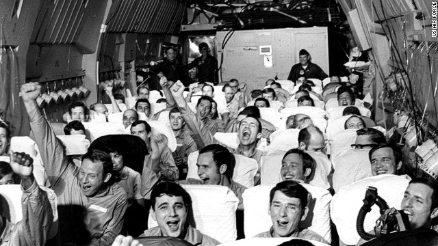 American ex-POWs celebrate leaving North Vietnam in 1973 aboard a C-141 Starlifter dubbed the Hanoi Taxi.