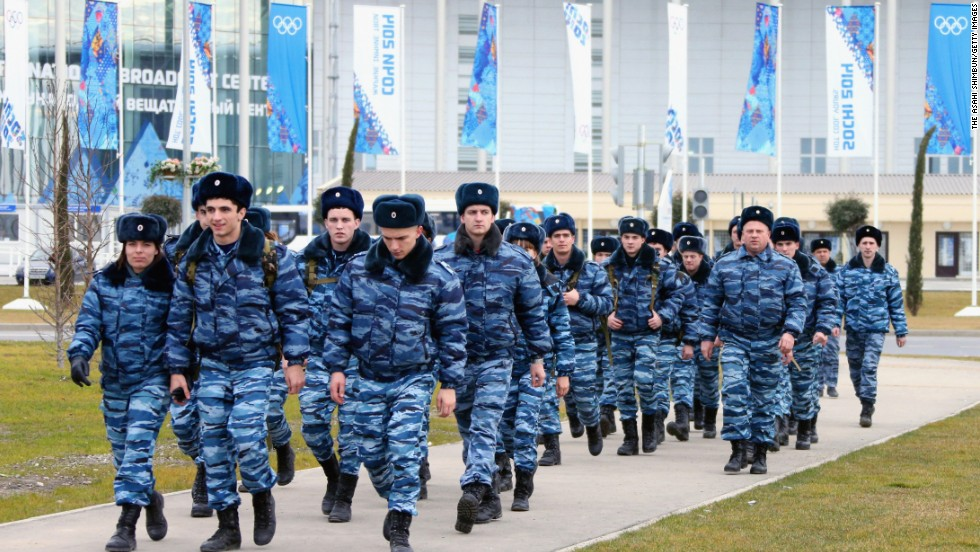 About 37,000 security officers will be deployed for the Sochi Games. Police officers walk in front of the main press center at the Olympic Park in Sochi on January 7, 2014.