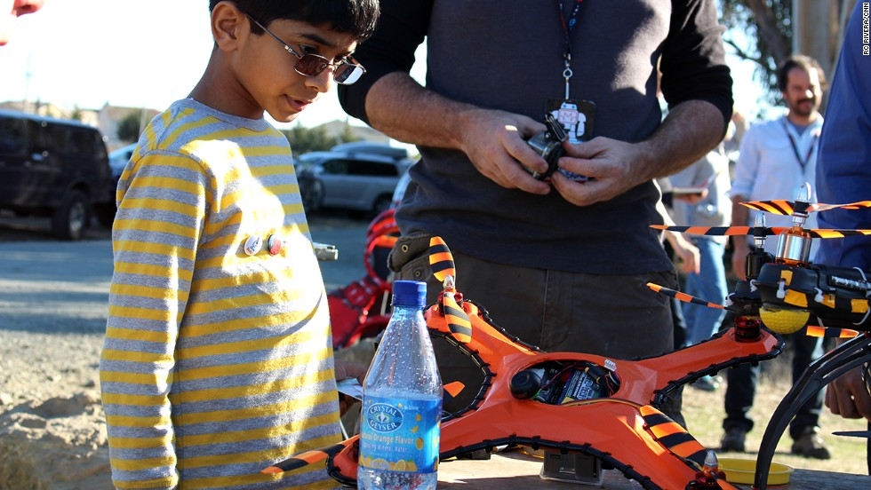 """A young drone fan checks out the <a href=""""http://www.gameofdrones.biz/"""" target=""""_blank"""">Game of Drones</a> damage-resistant flying vehicle, which can withstand paintball hits, shotgun blasts and baseball bats."""