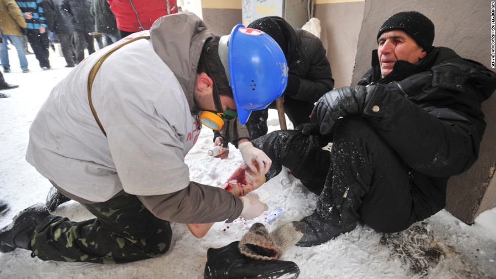 A medic treats an injured protester's leg during violent clashes between demonstrators and police.