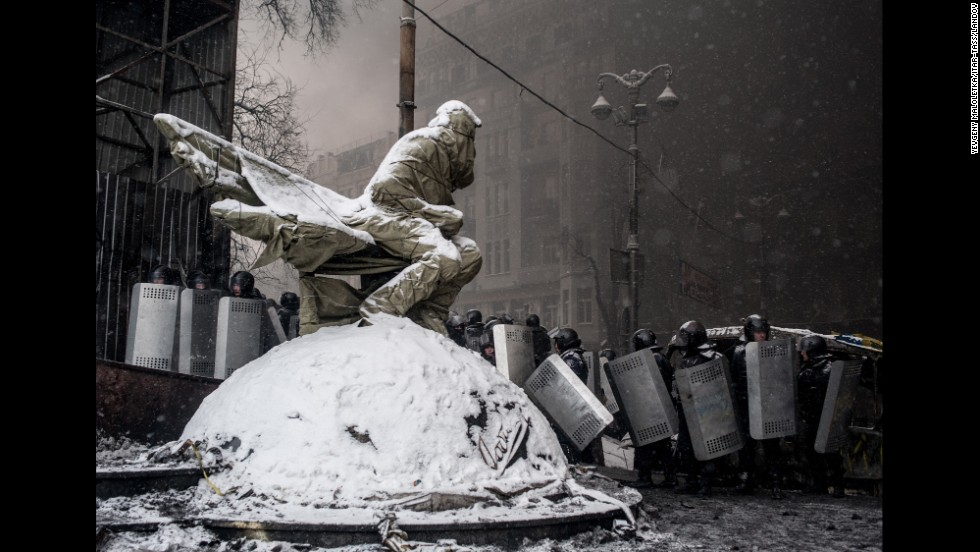 Riot police officers line up in Kiev during clashes on Wednesday, January 22.
