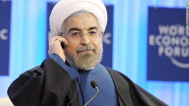Iranian president Hassan Rouhani listens after his address at the World Economic Forum in Davos on January 23, 2014. Some 40 world leaders gather in the Swiss ski resort Davos to discuss and debate a wide range of issues including the causes of conflicts plaguing the Middle East, and how to reinvigorate the global economy. AFP PHOTO ERIC PIERMONT (Photo credit should read ERIC PIERMONT/AFP/Getty