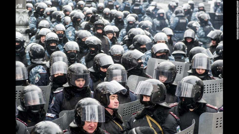 Riot police officers gather in Kiev on January 23.