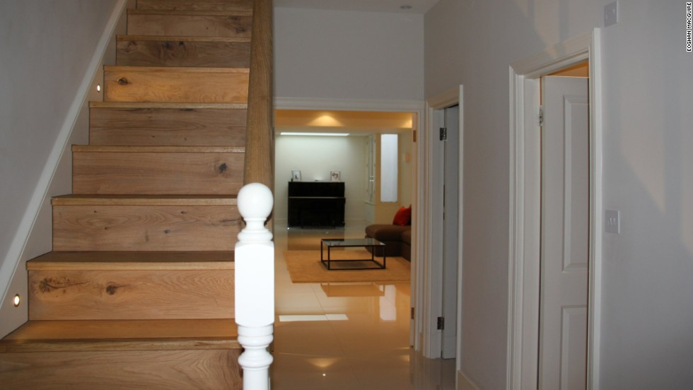 On the inside, however, a large basement extension hosts a lounge, bathroom, laundry room and spare bedroom.