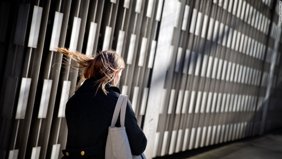 A woman's hair is blown by the wind while walking in downtown Atlanta on January 23.