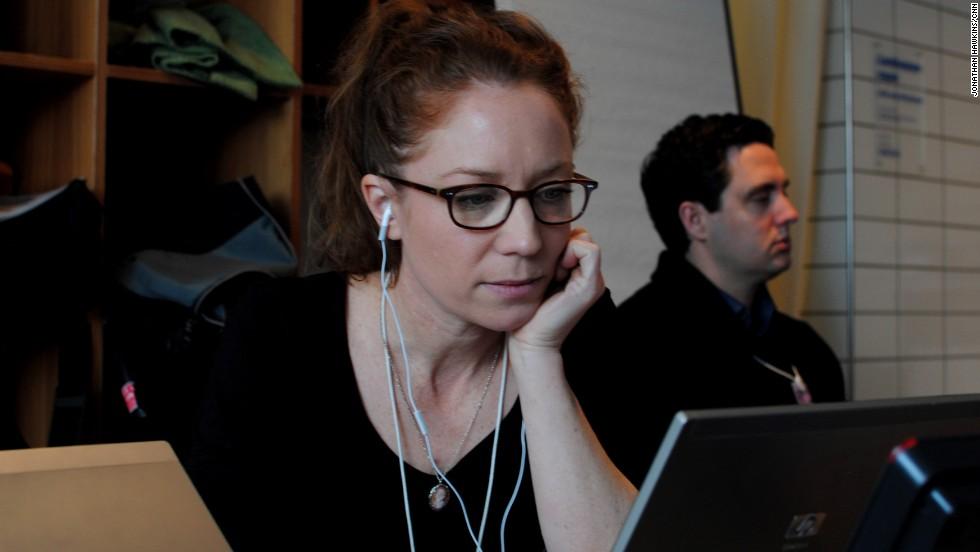 Irene Chapple, CNN digital producer, is working on her story in CNN's makeshift Davos bureau.