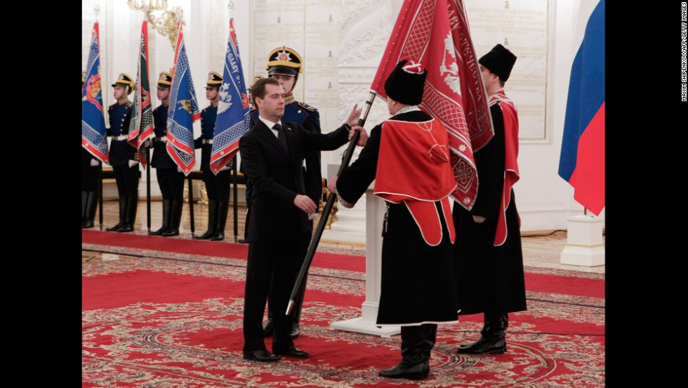 Then-Russian President Dmitry Medvedev hands over a flag  to one of the modern Cossacks organizations in Georgiyevsky (St. George) Hall of the Big Kremlin Palace in Moscow,in December 2011.