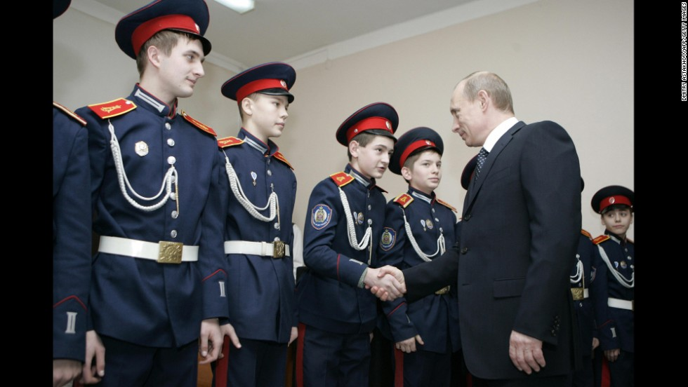 Russian President Vladimir Putin visits a Cossack cadet academy in Rostov-on-Don in February 2008.  Analysts have expressed concern that Moscow's new cozy relationship with the Cossacks could backfire, as some Cossacks have demanded more power and land rights.