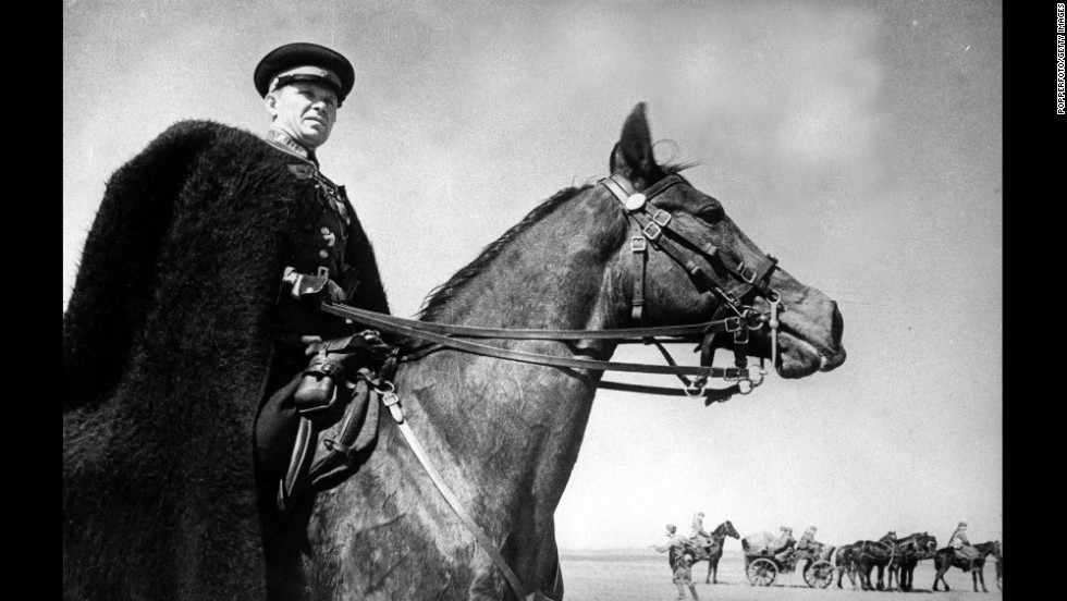 The commander of a Cossacks unit on Russia's southwestern front watches the progress of his troops during World War II in August 1942.