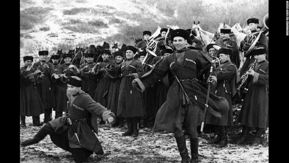 Soviet Red Army Cossacks enjoy a little downtime by giving a traditional dance performance in February 1938.