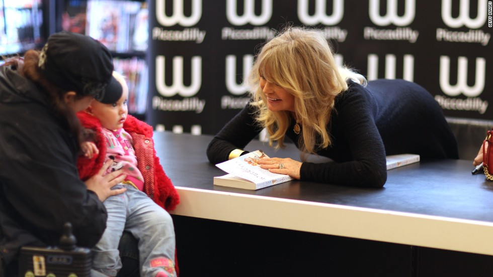 "Goldie Hawn meets a young fan as she signs copies of her book, ""10 Mindful Minutes"" on March 7, 2012 in London."