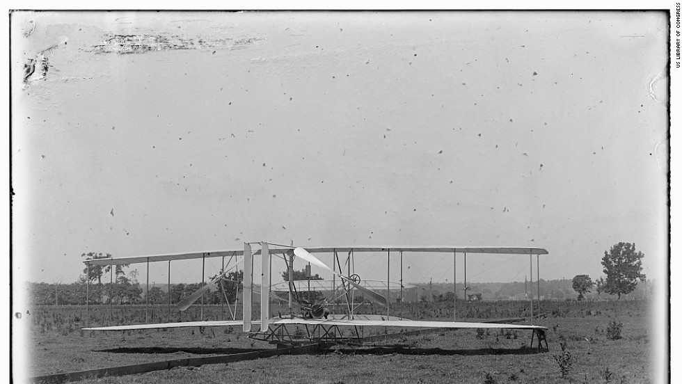 The Wright brothers' flying machine got airborne over the field via a launching track, left, that was attached to a catapult system.