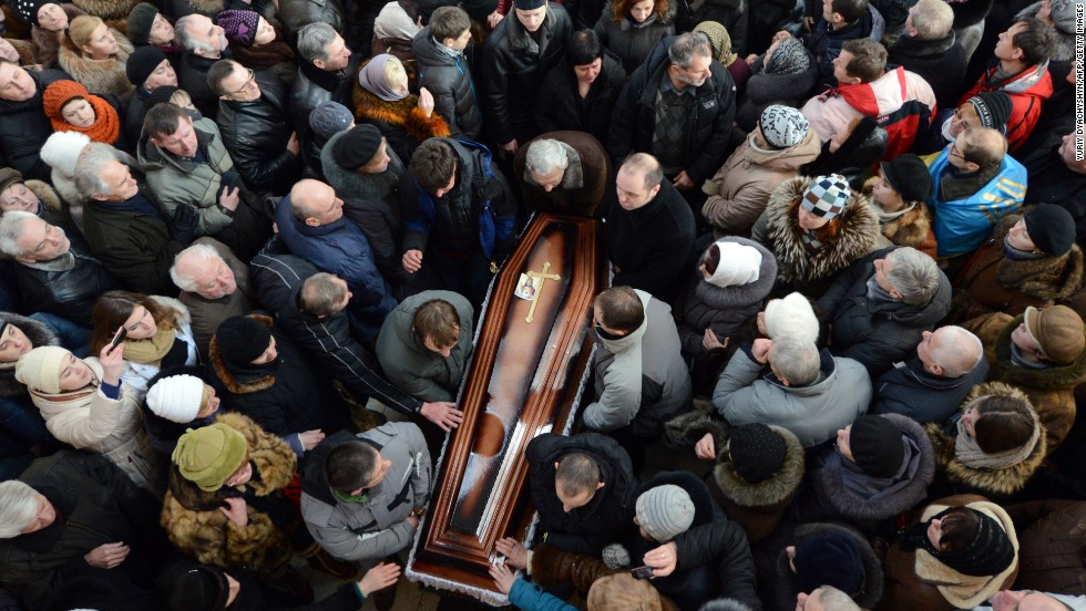 Some 10,000 Ukrainians take part in the funeral ceremony of dead protester Yuri Verbytsky in the western city of Lviv on Friday, January 24.