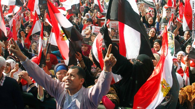 Egyptians backing General Abdel Fattah al-Sisi wave national flags during a rally in Cairo's Tahrir Square on January 25, 2014.