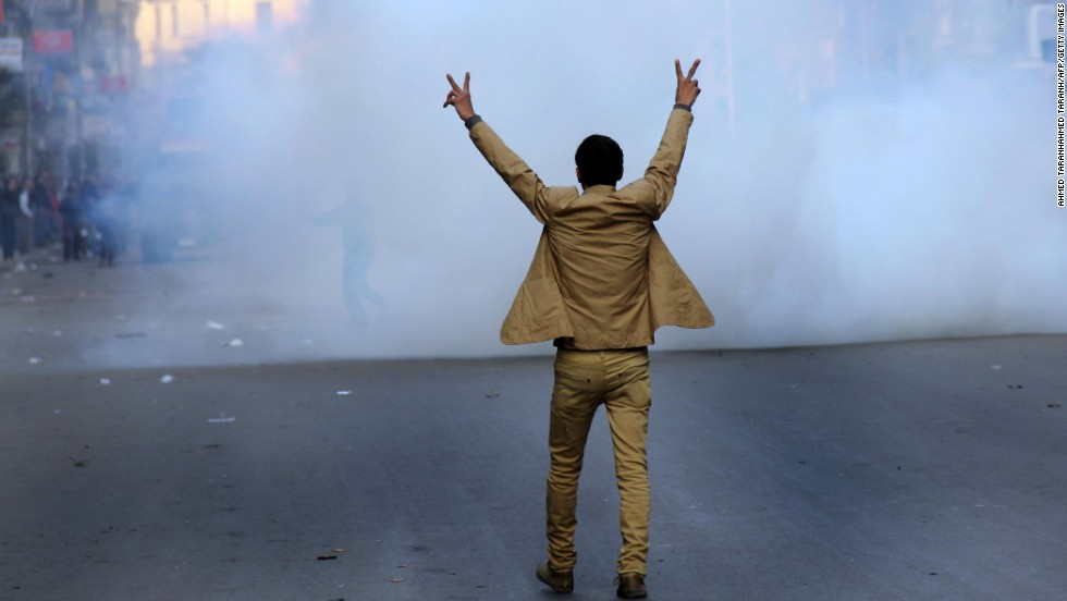 A supporter of the Egyptian military leadership flashes the victory sign during clashes with Muslim Brotherhood supporters.