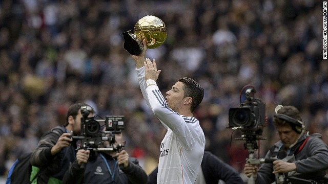 Cristiano Ronaldo shows the FIFA's Ballon d'Or to fans at the Bernabeu before the match against Granada on Saturday.