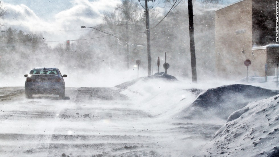 A strong wind kicks up snow Sunday, January 26, in Vadnais Heights, Minnesota, creating drifts over roads and parking lots.