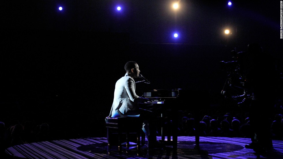 "John Legend takes center stage to perform his ballad ""All of Me."""