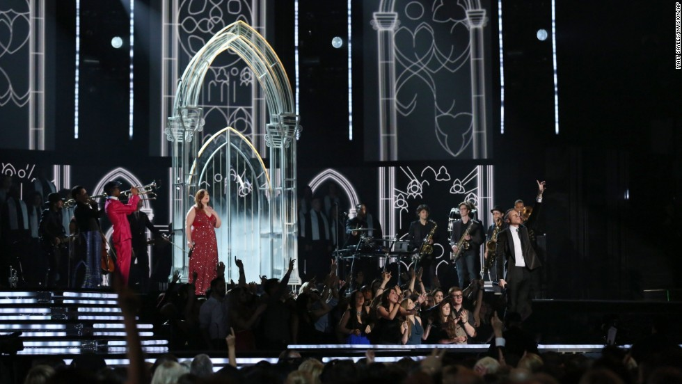 "Mary Lambert joins Macklemore for the performance of ""Same Love."" Earlier in the night, Macklemore and Lewis won the Grammy for best new artist."