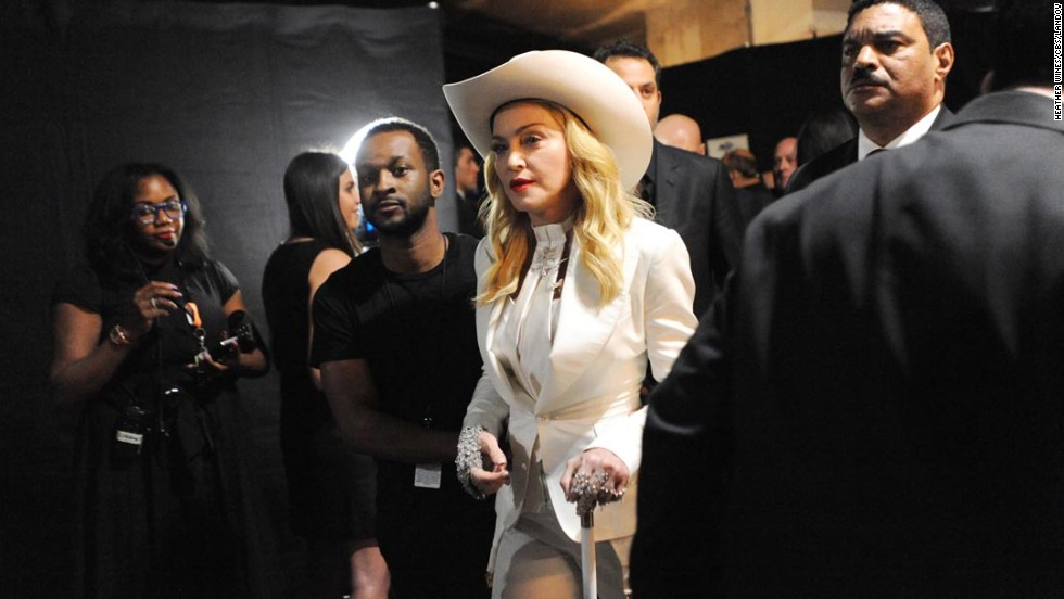 For a moment during Sunday's Grammy Awards, we wondered if we'd missed the memo about wearing all-white. Several stars both on the red carpet and on the stage looked like they were en route to a Diddy party with their glaringly pale ensembles, such as Madonna here, who wore white from hat to cane. Take a look to see what we mean: