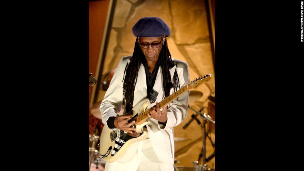 Musician Nile Rodgers topped off his sparkling white suit with a blue beret -- you know, just to keep it funky.