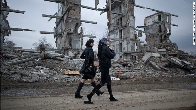 Two Chechen women walk in the outskirts of Grozny on March 7, 2011.