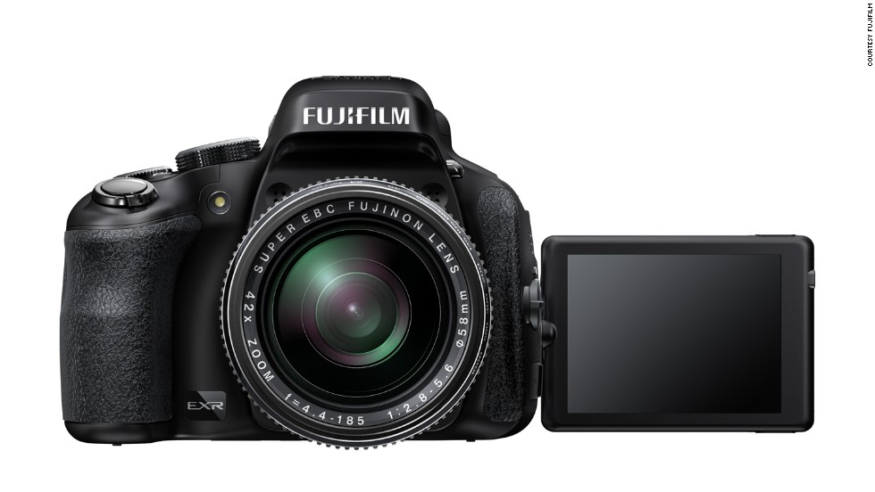 <strong>Fujifilm FinePix HS50EXR</strong>. This is a superzoom (bridge) camera with a fixed-lens that can zoom up to 42x and shoot in burst mode at 11 frames per second -- so you're covered whether you're shooting a safari or capturing the running of the bulls.
