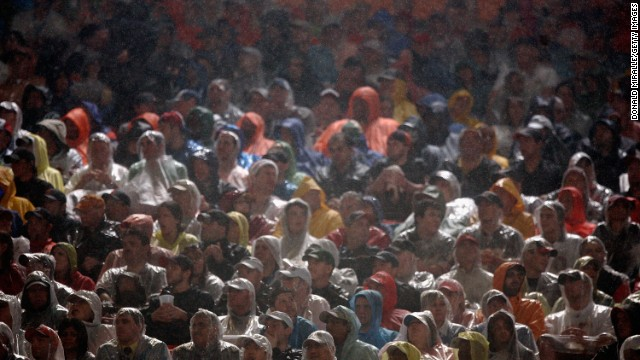 Fans sit in the rain as they watch Super Bowl XLI between the Chicago Bears and the Indianapolis Colts on February 4, 2007 at Dolphin Stadium in Miami Gardens, Florida.