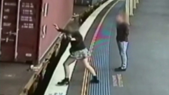 vo church woman survives jump onto moving freight train_00001330.jpg
