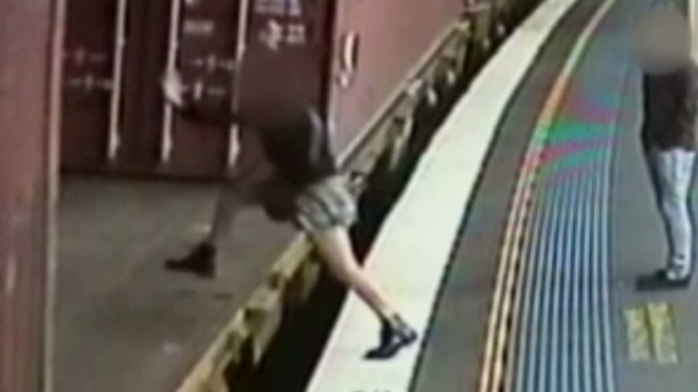 pkg aus woman jumps on moving train_00001119.jpg