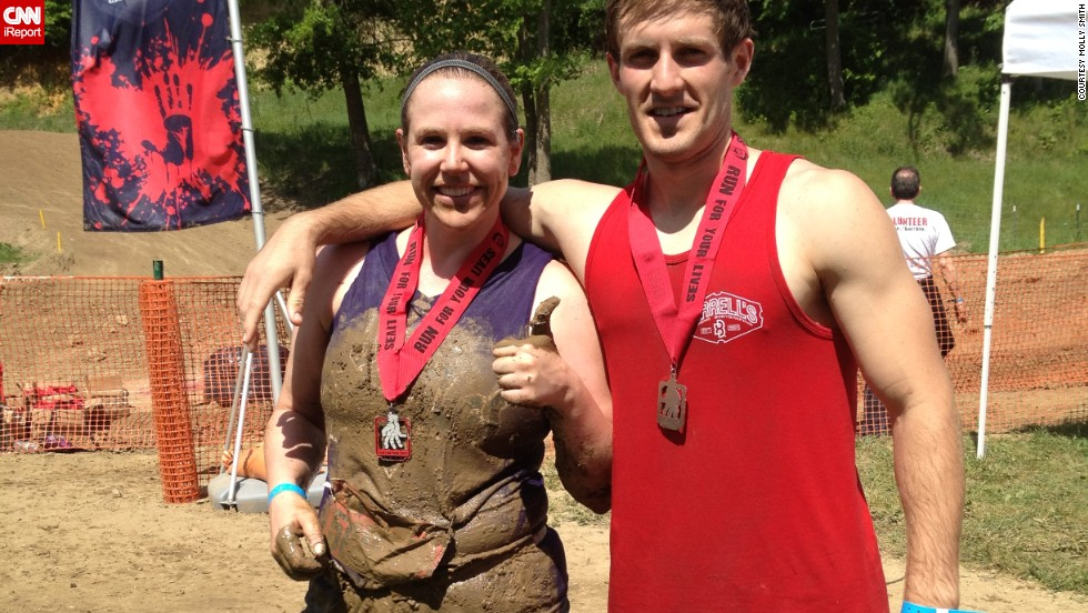 She has physical goals: Molly and her husband, Brady, are pictured here after completing a zombie obstacle race in 2012.