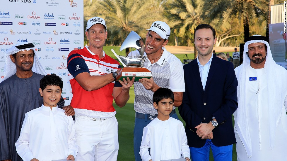 Sweden's Henrik Stenson and Rafa Cabrera-Bello of Spain share the Champions Challenge trophy after both finished six under par in the warm-up to Thursday's main event.