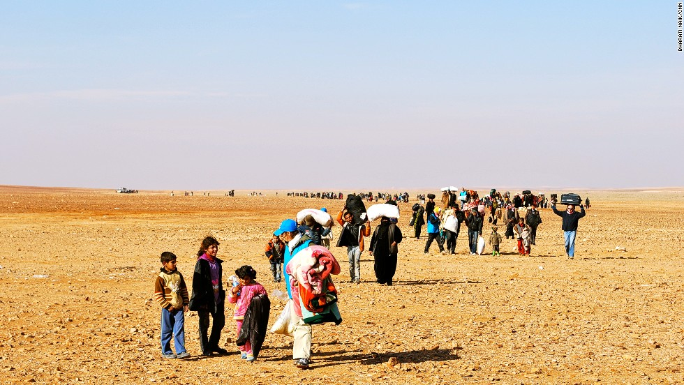 Hundreds of refugees make their way across the Syrian border into Jordan. Many have walked up to 20 kilometers to flee the ongoing civil war in Syria.
