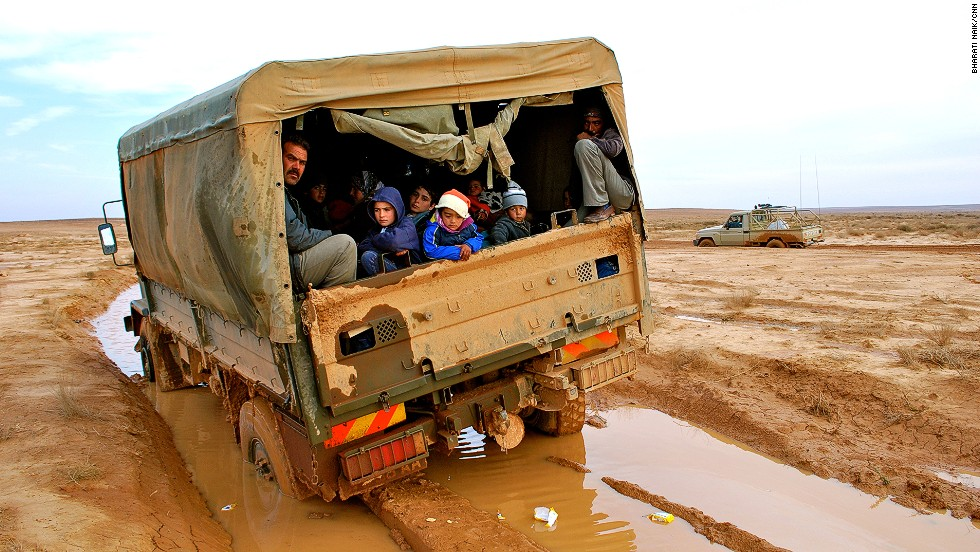 The road from the border to the camp is unpaved; here a Jordanian truck is stuck in the mud after recent spells of rain. The truck had to be pulled out of the mud by an armored personnel carrier.